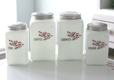 I want....  Set of 4 Milk Glass McKee Canisters. $299.00, via Etsy.
