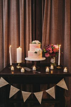 cake table with #bunting, photo by Clean Plate Pictures http://ruffledblog.com/romantic-brooklyn-winery-wedding #wedding #cakes