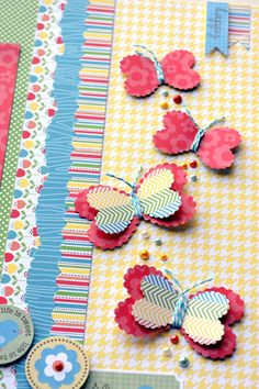 Make butterflies from heart punches and folded paper scraps... so cute!