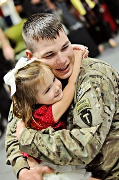 Soldier homecoming with daughter.  Priceless!!