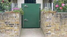 For doorways and openings against a step, swing-hinged flood gates are designed as permanent ... / Credits: Flood Control International