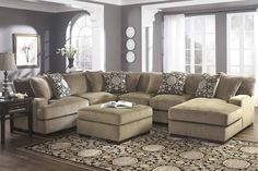 This Beautiful Fabric Sectional Sofa In Brown Boasts Of