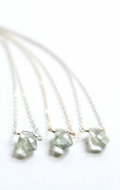 Tiny moss aquamarine solitaire necklace. From Kahili Creations of Hawaii...