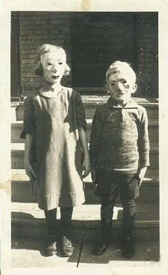 Creepy Vintage Halloween costumes.  Kids wearing homemade masks, 1905.