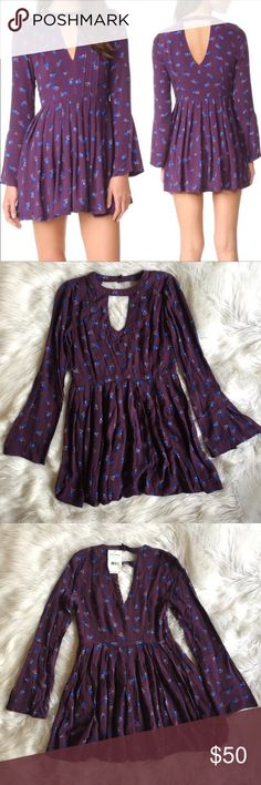 """Free People Tegan Printed Floral mini dress Size 0 FREE PEOPLE TEGAN PRINTED LONG SLEEVE MINI DRESS Size: 0 New with tags Measurements:  Length shoulder to hem 30"""" Waist: straight across 15"""" Purple dress with Allover floral print. High neck with keyhole details at front and back. Button through closure at back of neck. Side zip Waist seam with shirring. Pockets at skirts side seams. 100% rayon. Style #: OB536552 Ships from my smoke and pet free home Free People Dresses Mini"""