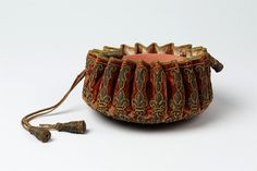 The gaming purses are flat-bottomed and round like a bowl, specifically shaped so that they can sit open on a table filled with coins, counters, or other game pieces. France 1660-1680.