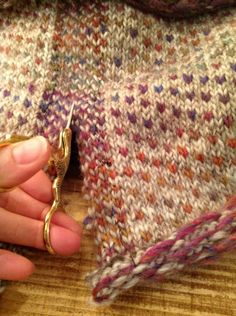 Cutting the steek. Can you hear those stitches screaming?!