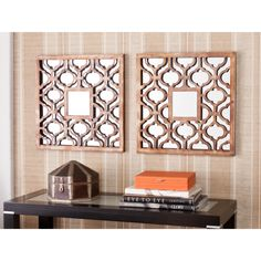 This decorative wall mirror set is a reflection of your good taste. This two-piece set features an intricate modern cutout design over each mirror for a stunning visual effect. The mirrors have a wood look that is actually metal with a bronze finish.