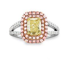 Do you like this ring?   1.11 carat VS1 clarity, Fancy Yellow color, cushion cut diamond with white diamond and pink topaz accents.  Very cool and unique ring!