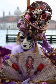 Beautiful purple and gold costume with a sheet music motif
