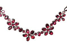 """Garnet pansy flower necklace. The pansy is one such example which used extensively employed during the Georgian sentimental era (1810-1840). The word itself is believed be a distortion of pronunciation of the French word """"pensee"""" for thought. The flower soon became synonymous with the phrase """"thinking of you."""" English c1820. The Three Graces."""