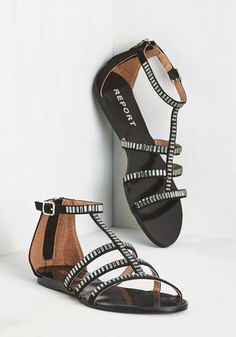 Craving a little sparkle in your strut? Look no further than these strappy black sandals from Report Footwear! Illuminating your gait with silver rhinestones, and given a touch of gloss with a polished footbed, these vegan faux-suede kicks satiate your hunger for style that shines!