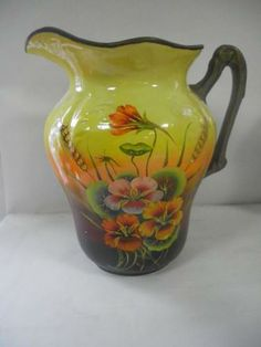 A rather stunning T G Green wash jug from a wash jug and bowl set. Air brushed in freehand the art work is stunning showing Nasturtium flowers c1900