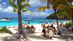View from the Soggy Dollar Bar on Jost Van Dyke in the British Virgin Islands. For info on how to download this image and others as high res wallpapers, visit beachbarbums.com. Here's to getting your dollars soggy!