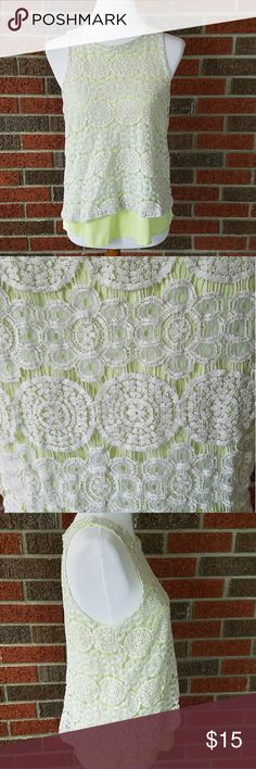 Lime Green Everly Lace Tank Top size Large Size Large. Everly lace tank top. Green colored fabric covered in a sheer lace. Lace has circle and flower patterns. No damage. Everly Tops Tank Tops