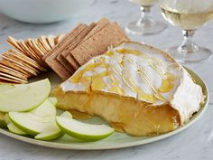 Baked Brie from FoodNetwork.com  Serve with apples and grapes or water crackers or slices of good bread toasted in oven.