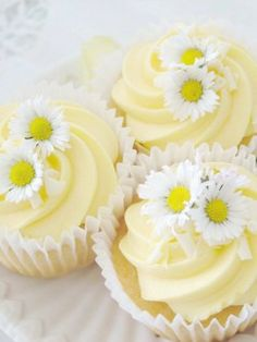 Daisy cakes- vanilla cakes with slightly yellow coloured vanilla butter cream icing decorated with daisies- will make these sometime