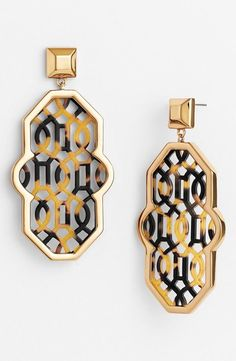 Navy and gold perforated lattice earrings.