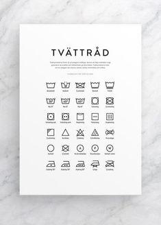 Tvättråd poster med tvättsymboler i tvättstugan
