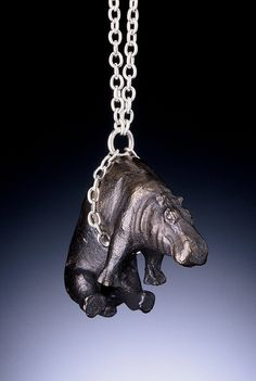 White bronze hippo pendant on a silver chain, by Kathleen R. Prindiville.