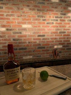This homeowner turned their basement to the ultimate hangout spot with a brick bar backsplash.   Product // Olde England Thin Brick  #thinbrick #glengery #backsplash #mancave #brickbar #interior #design #basementgoals #residence #brick