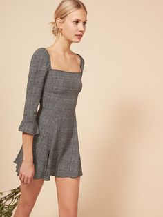 Well aren't you precious. This is a mini length, fit and flare dress with a square neckline and ruffled sleeves.