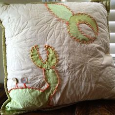 Thrift store pillow embellished with crab made from thrift store curtain & recycled buttons :)