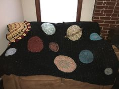 Handmade solar system crochet blanket for my nephew! I first did the blanket in sparkly black yarn and then came back and attached the planets.