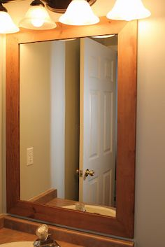 Framed Mirror (used router in the back) Upstairs Bathrooms, Small Bathroom, Bathroom Mirrors, Bathroom Staging, Bathroom Ideas, Huge Mirror, Mirror Mirror, New Toilet, Diy Frame