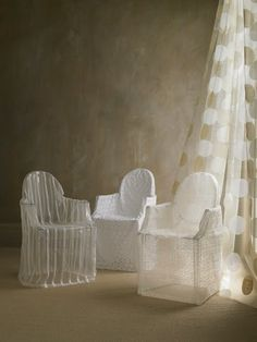 Organza and fine linen slipcovers over Philippe Stark 'Ghost' chairs....very ethereal. Holy Hannah.