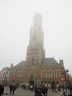 The top of the belfry disappearing in the fog, Bruges, Belgium