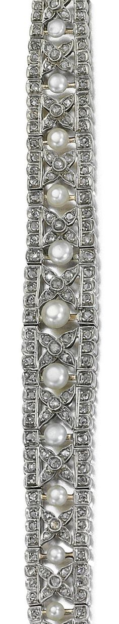 DIAMOND BRACELET, LATE 19TH CENTURY.   Designed as an open work tapered band to a central row of button pearls between floral motifs and lines set with rose-cut diamonds, length approximately 190mm.