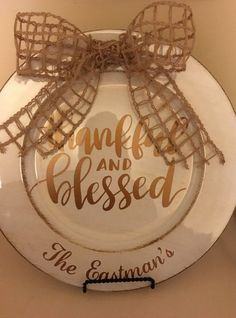 Decorative charger plate with vinyl decal Thankful & Blessed. **Add name to personalize this gift.  ** Shown in brown and copper metallic vinyl colors, but can do in any colors.  **Please note vinyl color in notes at checkout as well as family name. Please type family name exactly as you would like it Ex: The Eastmans - This is exactly how I will put it on the bottom rim of plate as in picture.  **Plate is cream distressed in brown tones.