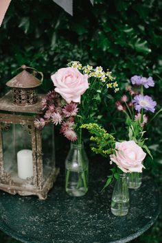 Decor- floral centerpieces and a rustic lantern