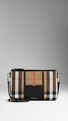 Burberry Black House Check and Leather Clutch Bag - House check cotton clutch bag with smooth sartorial leather panel. Top zip closure and detachable leather strap. Discover the women's bags collection at Burberry.com