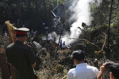 Rescue workers search an air force plane crash site near Nadee village, in Xiang Khouang province in the north of the country May REUTERS First Novel, Bury, Romance Novels, Bbc News, Southeast Asia, Laos, Around The Worlds, Romantic, Concert