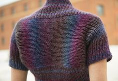 Prima Shrug - knit in one piece, no seaming. The back is knit from side to side to take advantage of the distinctive color gradation of the yarn. Its unique construction means that you can size as you go, ensuring a perfect fit customize to fit body and style.