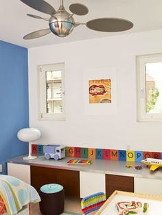 Storage Genius - Space was the big challenge when architects Jill and John Bouratoglou designed a bedroom for their 3-year-old son, Julian. The room is just 11 feet square, and it also had to double as a playroom, so they wanted to use every inch. They came up with innovative built-in storage solutions and made the space appear longer by painting the side walls blue and the end walls white. The result is an organized, modern room that doesn't cramp Julian's style.