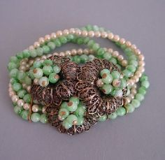 Miriam Haskell (Hess) 5-strand stretch bracelet with green glass beads and faux pearls. Circa 1940.