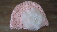 Crochet soft pink hat with silk flower