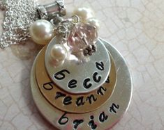 Kids names hand stamped necklace silver and gold necklace layered discs mixed metals. Hand stamped names necklace for moms. by glitterazzijewels. Explore more products on http://glitterazzijewels.etsy.com
