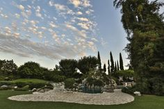 The Playboy Mansion is for Sale: Pool, Grotto, and Hef Included: Outdoor Amenities at the Playboy Mansion
