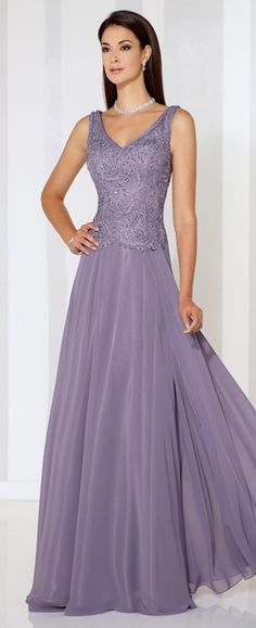 Sleeveless chiffon A-line gown with front and back V-necklines, ribbon work bodice with slight dropped waist, flyaway skirt. Matching shawl included.