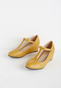 Haute Harmony Wedge in Mustard. With a count to three and a tap of the toes of your T-strap wedges, you lead the choir into a harmonious melody. #yellow #modcloth
