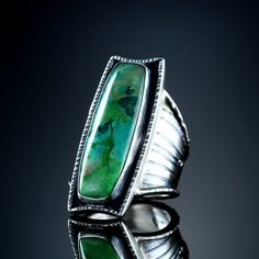Parrot Wing Chrysocolla Ring. Fabricated Sterling Silver. www.amybuettner.com https://www.facebook.com/pages/Metalsmiths-Amy-Buettner-Tucker-Glasow/101876779907812?ref=hl https://www.etsy.com/people/amybuettner http://instagram.com/amybuettnertuckerglasow