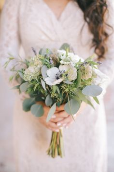 Full bridesmiad bouquets with anenomies and eucalyptus. Floral Occasions | The Villa Wedding | Brandon Kidd Photography