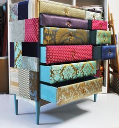 Now this is really interesting.  It would be the focal item in the room.  Each drawer is padded and covered with fabric.  Ends are as well.  It sell for $1,150.00 !  I think it would be a fun DIY
