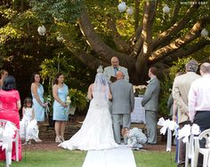 Real wedding of Daniel & Mary-Eleanor in the garden at Magnolia Manor, Colfax, NC.  {outdoor wedding, ceremony under big tree, greensboro, winston salem} Image by Whitney Gray Photography.