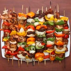 """GRILLED FAJITA SKEWERS  Serves 12-14  INGREDIENTS  1 to 2 onions, quartered 6 bell peppers, cut in 1.5"""" squares 1 pound cubed steak 1 pound cubed chicken breast 1 pound shrimp, deveined and peeled with the tail on 3 teaspoons salt (1 teaspoon per protein)  3 teaspoons pepper (1 teaspoon per protein)  3 tablespoons garlic powder (1 tablespoon per protein) 3 tablespoons chili powder (1 tablespoon per protein) 3 teaspoons cumin (1 teaspoon per protein)  PREPARATION 1. Place each meat in a…"""
