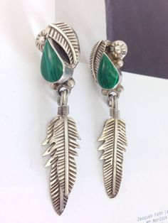 Looking for a statement earring? These malachite and Sterling silver feather earrings would do the trick. A personal favorite from my Etsy shop https://www.etsy.com/listing/385747818/vintage-taxco-mexican-silver-leaf-and